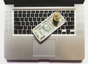 rupee note on laptop